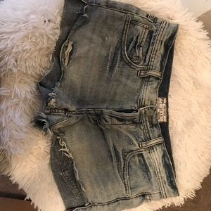 Free people button fly distressed denim shorts